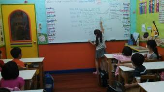Jenny, my first grade student leading the class for the afternoon's warmup.