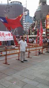 """China supporters were making a show of their """"ownership"""" of Taiwan this weekend. But this guy peacefully protested the show by waving a Taiwanese flag in front of the rows of Chinese ones"""